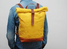 waxed Canvas Backpack, yellow color, hand waxed , with handles, leather base  and closures
