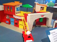 Fisher price town. How I loved twiddling the traffic lights on the bridge! I loved that you could put the mail in the little mail slot!!