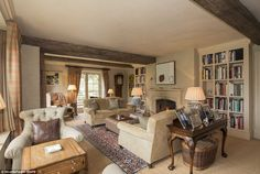 Rustic: The wooden beams dissecting this living room give the £4million new-build a more a...