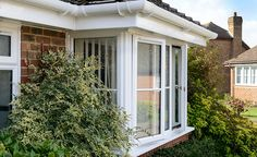 White uPVC gutter and fascia above a bay window.