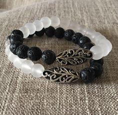 A personal favorite from my Etsy shop https://www.etsy.com/listing/467031067/frosted-white-czech-glass-and-black-lava