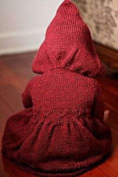 Ridinghood Sweater Pattern by Tina Good  the cable Xs are clever! There's a pretty pleat in it too