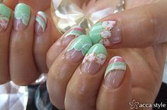 Nails with mint, peach, and white with a bow