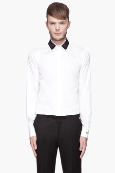 Dsquared2 White And Black Metallic Mesh Collar Carpenter Shirt -  Dsquared2 White And Black Metallic Mesh Collar Carpenter Shirt Dsquared2 Long sleeve shirt in white. Spread collar with black metallic mesh top layer. Button closure at front. Shirttail hem. Tonal stitching. Single_button barrel cuffs with logo embroidered at one. Price $495.00 Click HERE for...