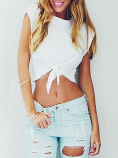 Ripped light wash jeans • knotted white bro tank