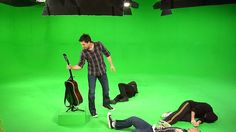 Doug Maverick saving his guitar from a band of martial artists in our green screen soundstage.