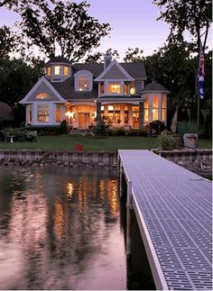 """1  st Place - Traditional Architecture (under 4,000 sf)      """"Cape-Cod-inspired lake home"""