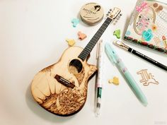 pyrography on 'acoustic guitar miniature DIY kit'  1/4 scale, 95x250mm, wood burning.
