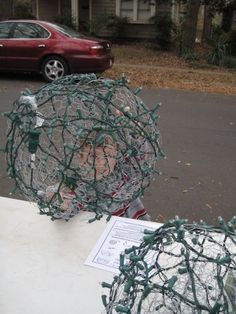 chicken wire Christmas ornaments for outside - I think I might would spray them them white with white strands of lights.