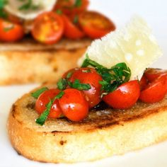 Bruschetta with tomato and basil. Chopped fresh tomatoes with garlic, basil, olive oil, served on toasted slices of French bread.
