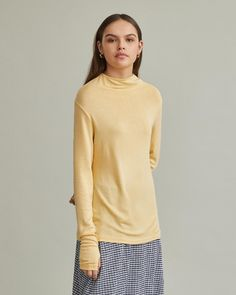 Long sleeve t-shirt with asymmetric cowl neckline. Long sleeves Asymmetric cowl neck Fine heavy knit viscose elastane Model is ft 9 in and is wearing a size S in Honey Apothecary, Designing Women, Cowl Neck, Neckline, Turtle Neck, Pullover, Long Sleeve, Sleeves, Model