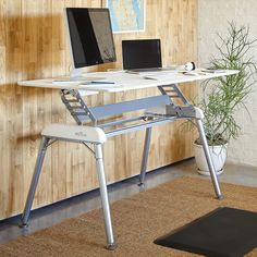 Brilliant! Height adjustable desk. They also make ones that sit on top of a table top that you already own. So cool!