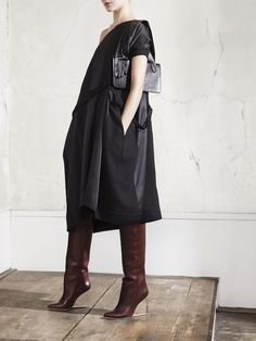 Maison Margiela x H & M, one-sleeve tent dress - wth pockets!  Very cool - and the clear-heel boots and glove clutch, too...
