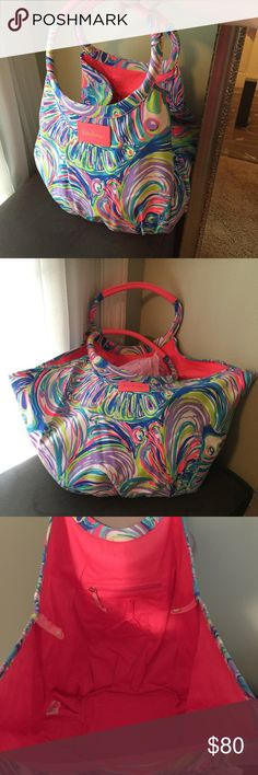 Lilly Pulitzer Bohemian Beach Tote Super cute beach Tote from Lilly Pulitzer! This bag has a snap to keep the bag closed or it can be unsnapped for an extra large size. Great for all of your beach necessities! Includes a zip pocket and a slip phone pocket. Canvas material. New and never used! Lilly Pulitzer Bags Totes