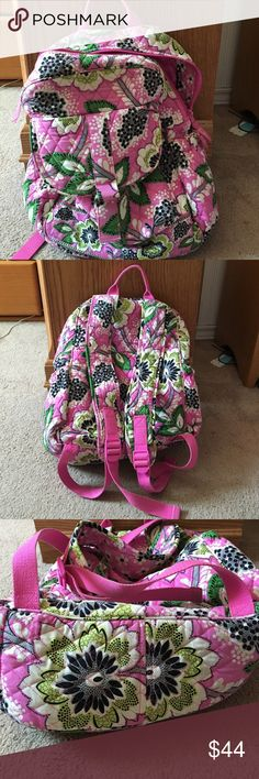 Pink Vera Bradley Backpack Get ready for back to school with this pink backpack with green, white and black flower patterns! Vera! In excellent condition. Bottom has no worn marks on it, just a few pen marks on the inside in the pen pocket. Perfect back pack for carrying multiple books and notebooks + extra front pockets for supplies and water bottle holders on each side. Vera Bradley Bags Backpacks
