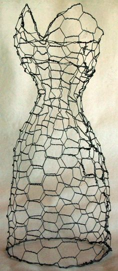 A feminine wire sculpture of a dress form done entirely in chicken wire. Sculpted, twisted & woven entirely by hand. Elegance meets the raw in the juxtaposition of the formal long dress & the media used. A sweetheart neckline, slender waist & full skirt make this an interesting piece that is one of my favorites! This custom piece will be made at a finished height of 25-30.    Expected completion, 7-10 days. I will email pictures of progress and completed project prior to shipping. This price…