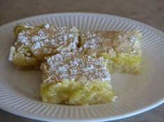 Lemon Bars    1. Crust    1 cup butter  ½ cup powdered sugar  2 cups flour  Mix powdered sugar and flour. Cut in butter. Press into 9×13 pan. Bake at 325 degrees for 20 minutes.    2. Filling    2 cups sugar  4 tablespoons flour  4 tablespoons lemon juice  4 eggs  Beat together until well mixed. Pour over warm crust. Return to oven and bake for 25 minutes. Sprinkle with powdered sugar. Cut when they are still slightly warm.