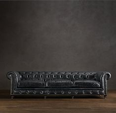 black tufted leather couch- tufted pieces always come home with me too