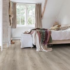 Have a tiny bedroom? Here are six tips for styling a small bedroom, including storage solutions, flooring, furniture sizing, colour palettes and lighting. Grey Laminate Flooring, Waterproof Laminate Flooring, Natural Wood Flooring, Real Wood Floors, Quick Step Flooring, Grey Oak, Wet Rooms, Decor Interior Design, Living Spaces