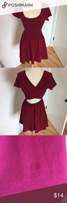C20 Forever 21 Red Cross Back Dress This dress is so perfect for fall! Apple red color with a gently flared skirt and a crisscrossing cutout back. Wear with a floppy black hat, denim jacket, leggings and boots. Only flaw is a small light stain on the skirt as shown. Size small. Forever 21 Dresses Mini