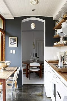 I could do our bottom cabinets this charcoal blue color, with butcher block counter tops, then leave the top cabinets white.  I think it would all contrast really well.