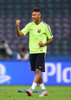 e022a5fac3 Neymar of Barcelona gestures during an FC Barcelona training session on the  eve of the UEFA