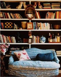bookcase arranging tips from littlegreennotebook. It looks like someone might actually read these books.