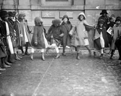 Youngsters play in the street, Harlem, 1920s.  Photo by New York Daily News.