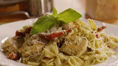 Pesto Pasta with Chicken | This flavorful, Italian-inspired pasta recipe combines sun-dried tomatoes and pesto sauce with sautéed garlic and red pepper flakes to create the perfect weeknight meal. The whole family will love this healthy, top-rated recipe.