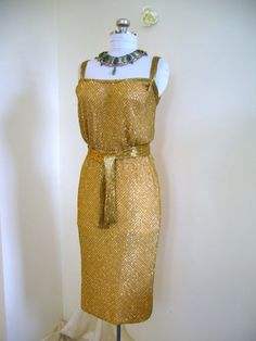 And if anyone has many extra thousands of dollars, I would like this please.  1950's Geil Chapman gold dress.