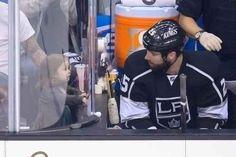 LA King turned Anaheim Duck Dustin Penner gets charmed by Harper Beckham.