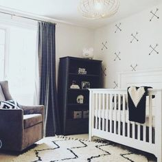Lovely Wall Decals put to use! Crossed arrows wall decal in this lovely monochromatic nursery by Ruffles and Rock!