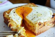 Croque Madame - French-style toasted ham and cheese topped with a fried egg recipe on Egg Recipes, Brunch Recipes, Breakfast Recipes, Cooking Recipes, Lunch Snacks, Food Porn, Breakfast Toast, Ham And Cheese, Antipasto