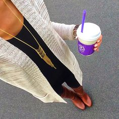 Oatmeal sweater with black outfit and cognac boots.