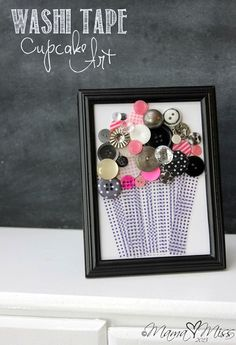 Washi tape cupcake art.  We carry the buttons, frames and the Washi tape to make this cute cupcake design.