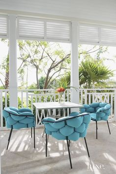 Eclectic White Lanai with Turquoise Accent Chairs