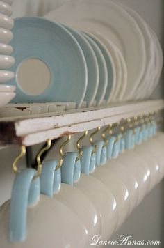 Way to repurpose an old shutter as a dish rack- love adding the hooks for teacups!