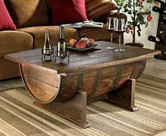 Whiskey Barrel Coffee Table - This vintage hand made oak whiskey barrel has been converted into a coffee table. It features a built in storage area and they are hand stained for that polished yet rustic look. $699.00 via amazon.