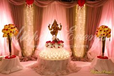 Beautiful Utopian Events Ganesh Table for your Welcome Area, Ethereal Backdrrop, Lighting, Drapes, Linens, Hydrangeas, Roses, Daisey's, Cylinder glass with floating candles. #UtopianEvents #IndianWeddings #Hydrangeas #Daiseys #Roses #Drapery #Drapes #Backdrop #Lighting #Centerpieces #WeddingFlowersAtlanta #WeddingsAtlanta #ReceptionsAtlanta #CeremonyAtlanta #AtlantaWeddings #GaneshTable