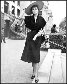 Model in black linen afternoon dress by Jeanne Lafaurie, photo by Seeberger, 1950