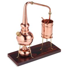 Classic European Copper Distiller - Hammacher Schlemmer, An alembic still used for centuries for making floral waters and essential oils