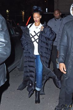 RiRi is no stranger to a sleeping bag-style coat, but it never fails to impress us with how chic she can make 'em look—even wearing just a white graphic T-shirt and cuffed jeans. It doesn't hurt that her beauty is on point with a navy blue ombré and wine-hued lips.    - MarieClaire.com