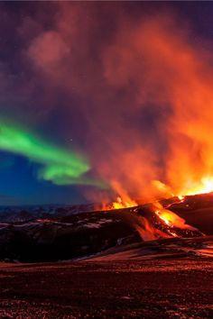 Wonders of Nature. Aurora Borealis over Volcano, Iceland