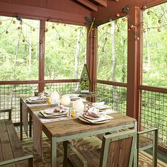 Deck out your screened porch for dining. Add seasonal sparkle with a string of your favorite lights. | SouthernLiving.com