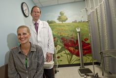 Holly Reineck, who is in treatment for Stage 4 Hodgkin's lymphoma, and her doctor, Dr. Robert Ruxer, at Texas Oncology in Fort Worth. During a treatment session, Reineck envisioned bright colors on the walls of the infusion room. Her vision has become a whole series of murals all around the room.