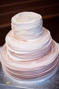 ruffles wedding cake idea via Piece of Cake Desserts / http://www.himisspuff.com/200-most-beautiful-wedding-cakes-for-your-wedding/18/