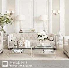 Beautiful furniture in a matching neutral palette adds texture and interest to all all-white room