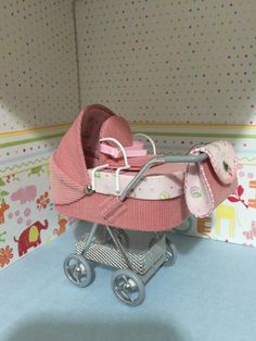 1/12th scale modern dolls house pram/stroller/buggy in soft pink needlecord, with alphabet black lining, toddler seat on top hand crafted