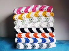 pile of crochet pillow covers