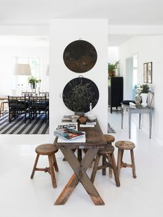 High contrasts by Rut Kara. From Est Magazine #living_room #white_room #white_floor #rustic #contemporary  #contrasts